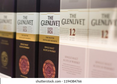 BUCHAREST, ROMANIA - JUNE 17, 2018: closeup of The Glenlivet single malt Scotch whisky packaging boxes with different flavors and label design standing on supermarket shelves