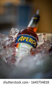 Bucharest, Romania - June 17, 2019: Illustrative editorial image of an Aperol bottle in an ice bucket, in Bucharest, Romania.
