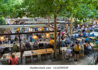 BUCHAREST, ROMANIA - JUNE 2, 2018:  Inner yard at Hanul lui Manuc (Manuc's Inn). a popular Romanian restaurant, Old city, Bucharest, Romania.