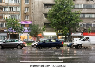 BUCHAREST, ROMANIA - JUNE 20, 2014: Rush Hour Traffic Downtown Bucharest On Magheru Avenue During Powerful Summer Storm.