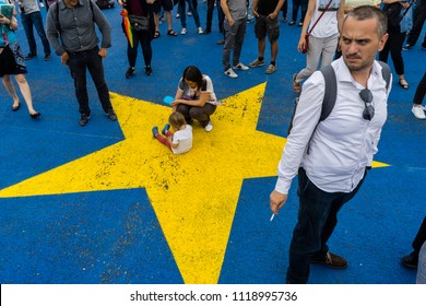 Bucharest, Romania, June 21, 2018:People of all ages attended the protest against new justice laws, corruption and government on the EU flag pavement painted.