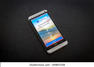 Bucharest, Romania - June 26, 2015: Microsoft Outlook email app on screen of a mobile smartphone. Microsoft launches new office productivity tools apps for mobile devices.
