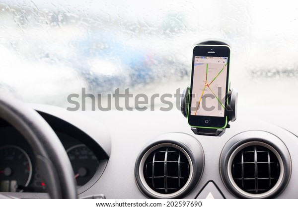 BUCHAREST, ROMANIA - JUNE 27, 2014: Photo of an iphone 5C with google maps in the car