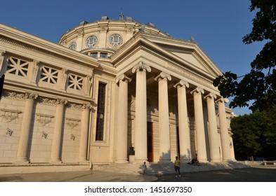 "Bucharest, Romania - June 7, 2019: Building of Romanian Athenaeum, home of ""George Enescu"" Philharmonic, landmark of Romanian capital city, inaugurated in 1888."