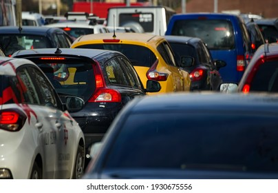 Bucharest, Romania - March 03, 2021: Cars in traffic at rush hour on a boulevard in Bucharest.