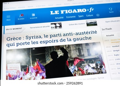BUCHAREST, ROMANIA - MARCH 08, 2015: Le Figaro Newspaper On Apple iPad Tablet. Le Figaro is a French daily newspaper of record founded in 1826 and published in Paris.