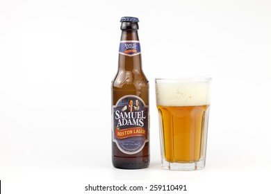 BUCHAREST, ROMANIA - March 09, 2015: A bottle and a glass of beer Samuel Adams  on white. Samuel Adams is produced by the Boston Beer Company. The company was founded in 1984 in Boston, USA