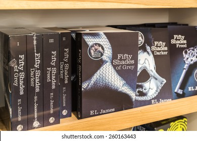 BUCHAREST, ROMANIA - MARCH 12, 2015: Fifty Shades of Grey Bestseller Books For Sale On Library Shelf. Written in 2011 it is an erotic romance novel and was sold in over 100 million copies worldwide.