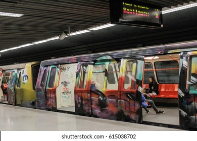 BUCHAREST, ROMANIA, March 13, 2016: Subway train painted with graffiti is stationed in a metro station in Bucharest.