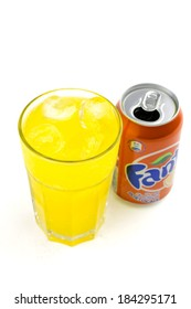BUCHAREST, ROMANIA - March 17 , 2014:330ml Fanta Bottle Can Isolated On White Background with glass and ice.