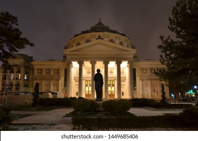 Bucharest, Romania - March 18, 2018:   Romanian Athenaeum concert hall, landmark of Romanian capital city illuminated at evening. Early spring with snow.