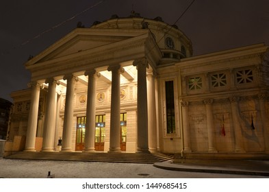 Bucharest, Romania - March 18, 2018:   Romanian Athenaeum concert hall, landmark of Romanian capital city illuminated on winter night.