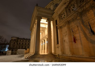 Bucharest, Romania - March 18, 2018:   Romanian Athenaeum concert hall, landmark of Romanian capital city and home of `George Enescu` Philharmonic illuminated in the evening. Side view.