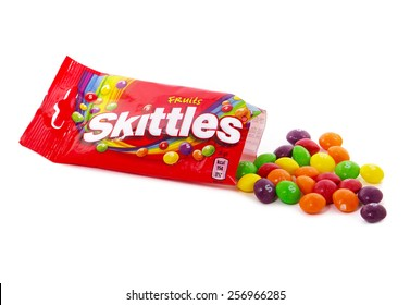 BUCHAREST, ROMANIA -?? MARCH 2, 2015. Skittles Candy isolated on white. Skittles is a brand of fruit flavoured sweets, produced by the Wm. Wrigley Jr. Company, a division of Mars, Inc.