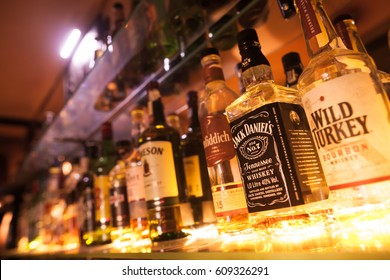 BUCHAREST, ROMANIA - March 22, 2017: Illustrative editorial image of some alcohol bottles in a row, displayed in a pub or restaurant.
