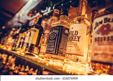 BUCHAREST, ROMANIA - March 22, 2017: Editorial image of some alcohol bottles in a row, displayed in a pub or restaurant.