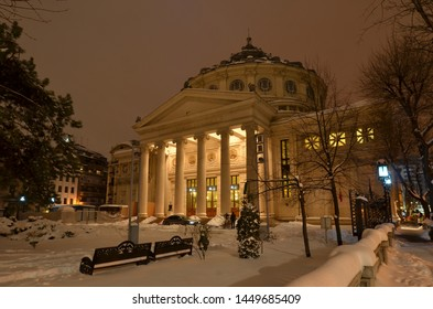 "Bucharest, Romania - March 23, 2018:   Romanian Athenaeum concert hall, home of ""George Enescu"" Philharmonic and landmark of Romanian capital city illuminated on winter night."