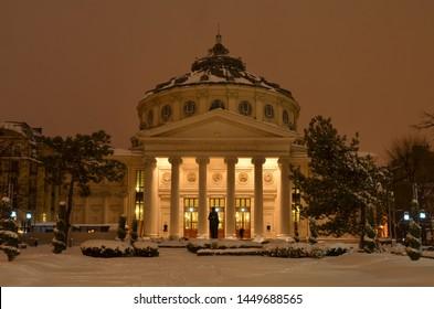 Bucharest, Romania - March 23, 2018:   Romanian Athenaeum concert hall, landmark of Romanian capital city illuminated on winter night.