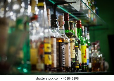 Bucharest, Romania - March 26, 2016: Several types of bottled alcohol are displayed on some shelves in a pub in Bucharest, Romania.