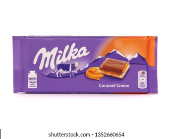 BUCHAREST, ROMANIA - MARCH 28, 2019. Milka caramel creme chocolate bar, marketed by Mondelez International. Milka is the first milk chocolate bar in the world.
