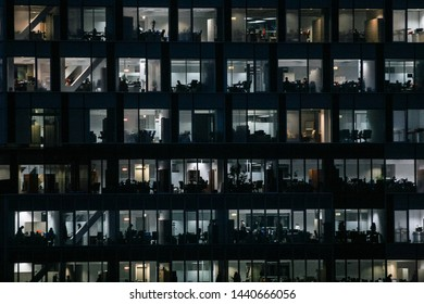 BUCHAREST, ROMANIA - March 4, 2010: Office building in the middle of the night. Late work, overtime, busy employees.