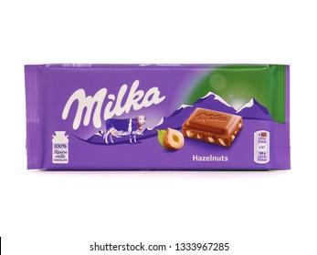 BUCHAREST, ROMANIA - MARCH 9, 2019. Milka alpine milk chocolate bar with hazelnuts, marketed by Mondelez International. Milka is the first milk chocolate bar in the world.