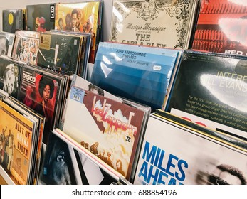 BUCHAREST, ROMANIA - MAY 06, 2017: Vinyl Record Cases Of Famous Music Bands For Sale In Music Store.