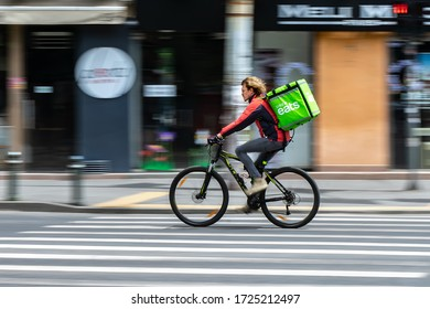 Bucharest, Romania - May 07, 2020: An Uber Eats food delivery courier on a bike in high speed. Restaurants are closed and only deliveries are allowed during the state of emergency due to coronavirus