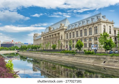 BUCHAREST, ROMANIA - MAY 10, 2014: Palace of Justice in downtown Bucharest, with Dambovita River in beautifull sunny day