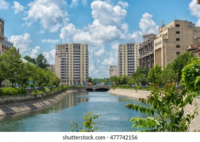 Bucharest, Romania - May 10, 2016: Cityscape from Bucharest during summer with bridge over Dambovita river on famous square called United Nations Square (Piata Natiunilor Unite in romanian)