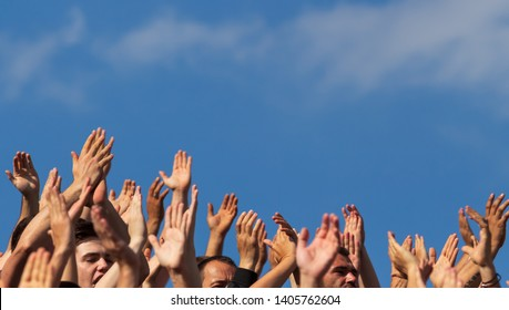 Bucharest, Romania - May 12, 2019: Supporters with their hands raised to the sky support their favorite team at a sports competition in Bucharest.