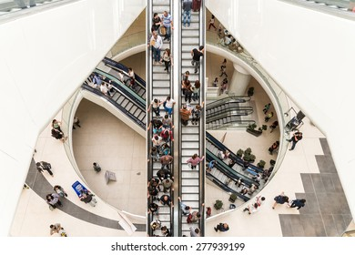 BUCHAREST, ROMANIA - MAY 14, 2015: People Crowd On Escalators In Luxury Shopping Mall.