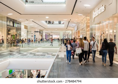 BUCHAREST, ROMANIA - MAY 16, 2015: People Shopping In Luxury Shopping Mall Interior.