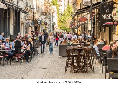 BUCHAREST, ROMANIA - MAY 17, 2015: People Enjoy Spring Time Downtown Lipscani Street, One Of The Most Busiest Streets Of Bucharest.