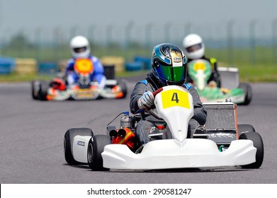 BUCHAREST, ROMANIA - MAY 17: Unknown pilots competing in National Karting Championship 2015 at Amkart Bucharest, on May 17, 2015 in Bucharest, Romania
