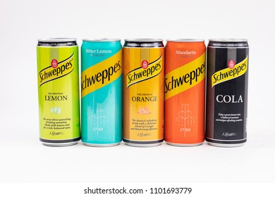Bucharest, Romania: May 2018: Photo of  different colored cans with different flavors of carbonated beverages made by Schweppes. New design cans isolated on white background.