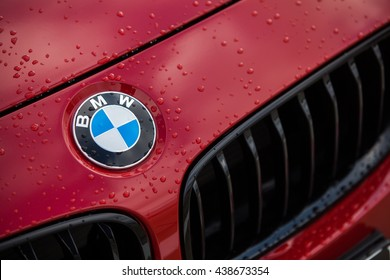 Bucharest, Romania - May 22, 2016: Detail of the vent of a BMW logo on a car, on a rainy day. BMW is a vehicle, motorcycle, and engine manufacturing company from Munich, Bavaria, Germany