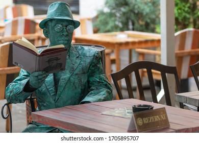 Bucharest, Romania - May 25,2018, Man reading a book, Living Statues, Nuno Faria Portugal, Street Theater Festival, Cismigiu Park