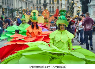 Bucharest, Romania - May 29, 2014: Female dancers in large exotic colorful costumes present The Giant Flowers show during the B-Fit International Street Theater Festival in the historic center.