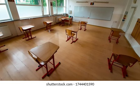 Bucharest, Romania - May 29, 2020: School classroom with the desks spaced to avoid the risk of coronavirus infection during exams is presented to members of the press by the mayor of sector 4.