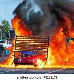 BUCHAREST, ROMANIA - MAY 29: Unknown driver and stuntman pass through fire with his car during the  ''Stunt Cars Show'' on May 29, 2011 in Bucharest, Romania