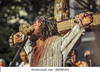 BUCHAREST, ROMANIA - MAY 3, 2013: Unidentified man plays Jesus Christ suffering on the cross during the street reenactment of the Way of the Cross.