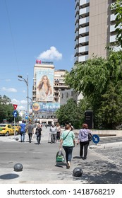 Bucharest, Romania - May 30, 2019: View of Nicolae Balcescu Boulevard near the University Square and InterContinental Hotel.