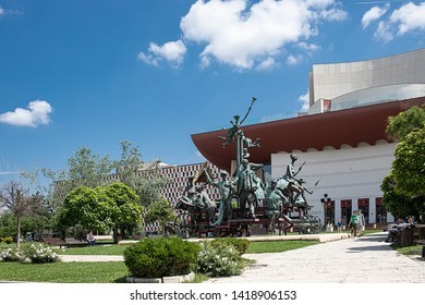 BUCHAREST, ROMANIA - May 30, 2019: Odd statue in front of the National Theatre, called The Dray With Pagliacci, a tribute to Romania's best loved playwright, Ion Luca Caragiale.