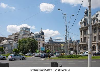 Bucharest, Romania - May 30, 2019: Traffic at University Square downtown Bucharest.