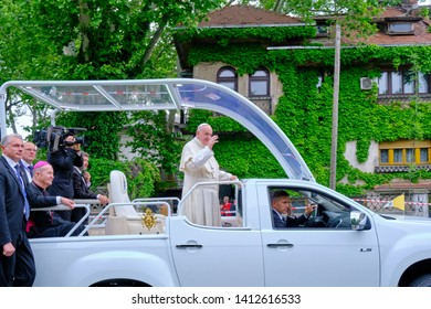 Bucharest, Romania - May 31, 2019: Pope Francis waving to the people in Bucharest from his popemobile, after leaving People Salvation Cathedral, during his 2019 visit in Romania.