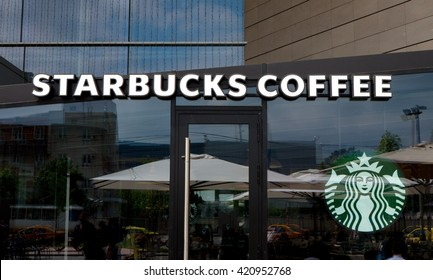 Bucharest, Romania, May 8, 2016: Starbucks logo and store front. Starbucks Corporation is an American coffee company and coffeehouse chain. it was founded in Seattle, in 1971.
