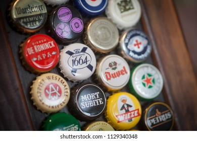 Bucharest, Romania - May 8, 2018: Illustrative editorial image of some branded beer bottle caps displayed on a wall in Bucharest, Romania.