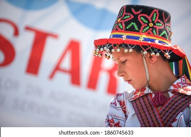 Bucharest, Romania - May 9, 2010: Portrait of a young boy dressed in a traditional costume of the Romanian ancient dancers Calusarii.