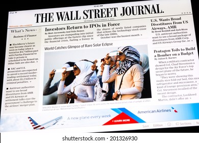 BUCHAREST, ROMANIA - NOVEMBER 04, 2013: The Wall Street Journal Newspaper On Apple iPad Tablet. Is an American international daily newspaper with a special emphasis on business and economic news.